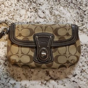 Tan and Brown Coach Wristlet